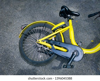 High Angle View of Yellow Bicycle Fell Over on the Road