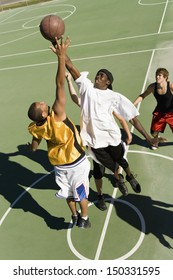 High angle view of young men playing basketball on court