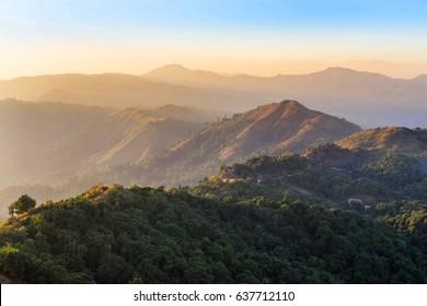 high angle viewpoint sunset over rainforest mountains at border between thai -  myanmar at Ban I-Tong, Pilok, Thong Pha Phum. Kanchanaburi, Thailand