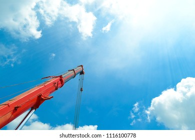 High arms of crane in building site.truck crane with hanging hook.