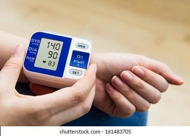High blood pressure. woman measures the pressure