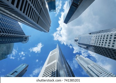 high building financial business area with cloud blue sky,look up view,blue business tone