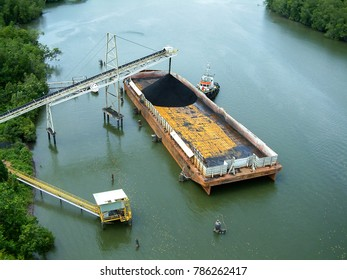 High capacity coal barge at a river