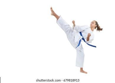 A high circular kick is struck by an athlete with a blue belt