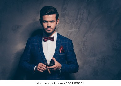 High class work job people person concept. Close up photo portrait of handsome serious elegant strict in white shirt burgundy accessories man holding brandy in hand isolated on gray background