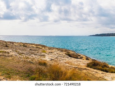 high cliff above the sea, summer sea background, many splashing waves and stone, sunny day