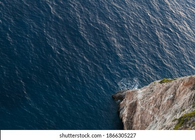 High cliff and sea water, top view. Rocky coast of Zakynthos island, Greece
