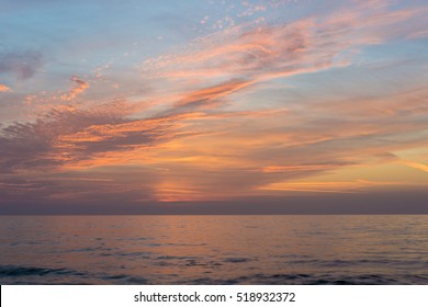High clouds lit by the sunset over the sea