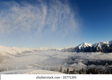 High cloudy mountains under snow in the winter