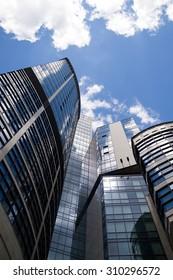High concrete building against the blue sky