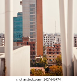 A high concrete building captured from another rooftop