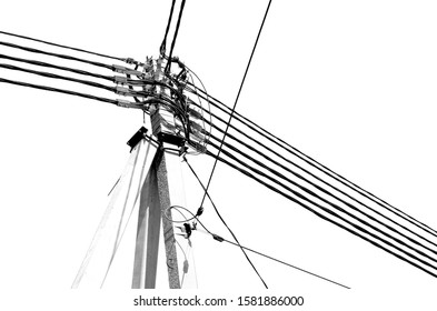 High concrete pole with lots of electrical wires isolated on white background.