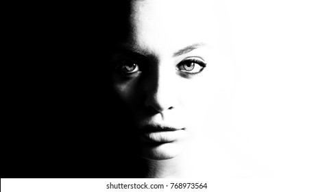 High contrast black and white portrait of a beautiful girl.