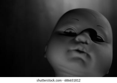 high contrast creepy doll's face look like a murder