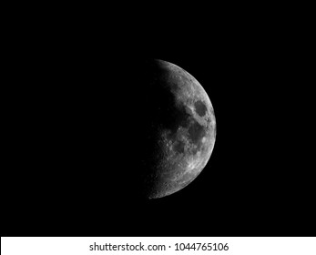 High contrast First quarter moon seen with an astronomical telescope