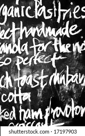 high contrast handwritten chalk menu on blackboard