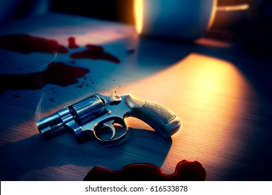 High contrast image of a bloody crime scene with gun on the floor