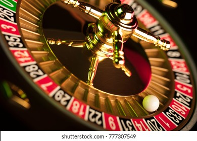 High contrast image of casino roulette and poker chips on bokeh background. Place for text.