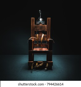 High contrast image of an electric chair scale model on a dark backgorund