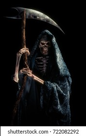 High contrast image of the grim reaper with a scythe / mixed media.