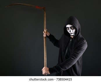High contrast image of the grim reaper with a scythe