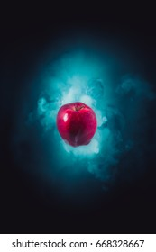 high contrast image of a poisoned apple on a black background