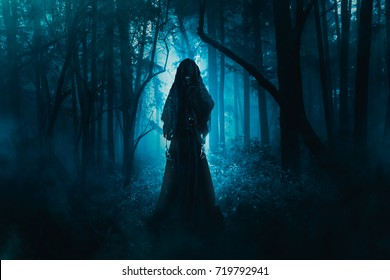 High contrast image of a scary ghost in the woods