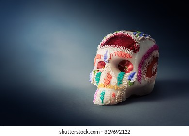 "High contrast image of sugar skull used for ""dia de los muertos"" celebration in a grey background"
