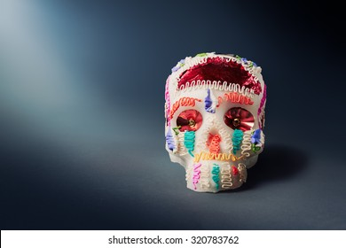 "High contrast image of sugar skull used for ""dia de los muertos"" / day of the dead celebration in a grey background"