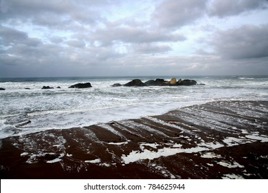 High contrast seascape of rocky Oregon Coast on a cloudy day