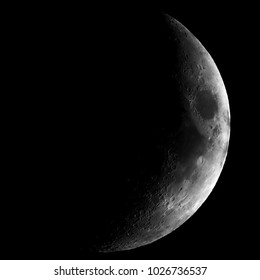 High contrast Waxing crescent moon seen with an astronomical telescope - close crop in black and white