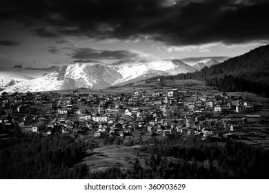 high contrasted black and white picture of mountain village in winter