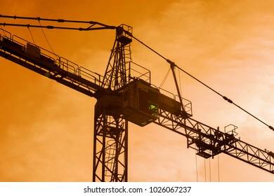 high crane silhouette on cloudy evening lighting