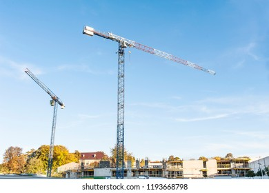 High cranes on the construction site in a sunny day.