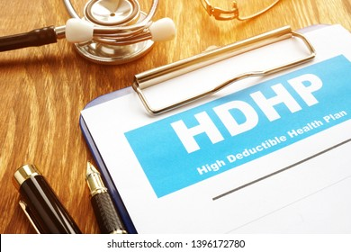 High Deductible Health Plan HDHP with clipboard.