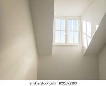 high dormer window acting as a sky light in a hall way shedding natural light into a residential home