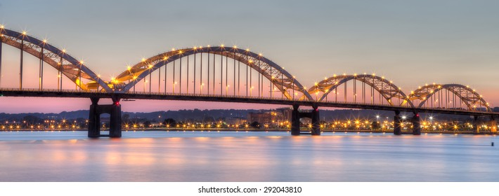 High Dynamic Range (HDR) image of Centennial Bridge connecting Moline, Illinois to Davenport Iowa across the Mississippi River in the Quad Cities at dusk