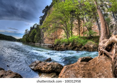 A High Dynamic Range photo of a natural spring flowing into a lake