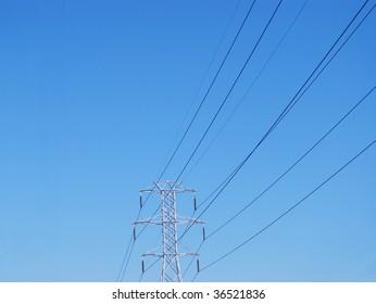 a high electricity pylon against blue sky