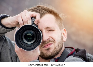 High end camera user.  Camera operator. Photographing the photographer.