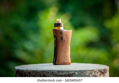 high end rebuildable dripping atomizer with stabilized natural walnut wood regulated box mods, vaping device, selective focus