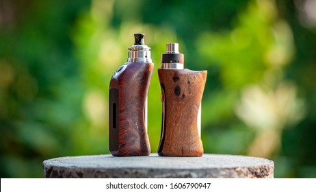 high end rebuildable dripping atomizer with natural stabilized wood regulated box mods, vaporizer equipment, selective focus