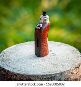 high end rebuildable dripping atomizer with stabilized natural redwood burl regulated box mods, vaping device, selective focus