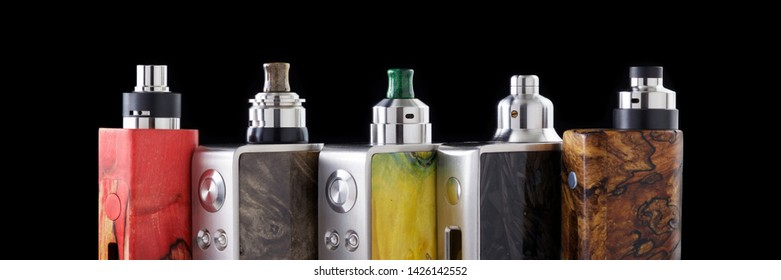high end rebuildable dripping atomizers for flavour chaser on regulated stabilized wood box mods isolated on black background, vaping device, 3 x 1 ratio