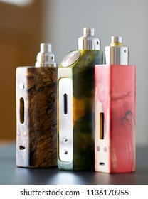 high end stabilized wood regulated box mods with rebuildable dripping atomizer and drip tip, vaping device, vape gear, vaporizer equipment, selective focus