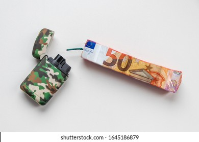 High explosive money-fireworks ready to be detonated by matches or pocket lighter shows risk of money waste at silvester and on new years eve as happy new year fire cracker and banger pyrotech