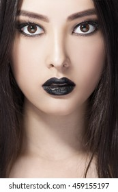 High Fashion Beauty Model Girl with Black Make up and Long Hair. Black Lips. Dark Lipstick and White Skin. Vogue Style Portrait.