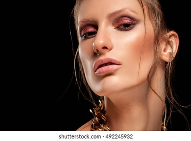 High fashion look, closeup beauty portrait. Bright makeup with perfect clean skin.Closeup beauty portrait on black isolated background.