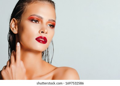 High fashion look. Glamor closeup beauty portrait of beautiful young woman model with bright makeup. Winter
