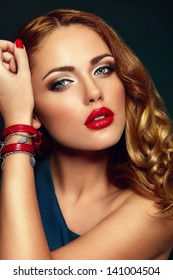 High fashion look.glamor closeup portrait of beautiful sexy stylish blond Caucasian young woman model with bright makeup, with red lips,  with perfect clean skin with colorful accessories